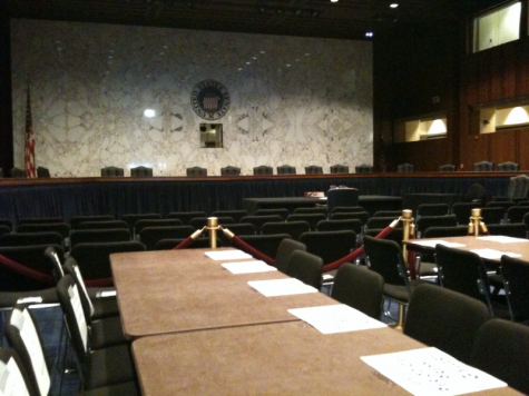 """Empty hearing room"" by Jay Tamboli"