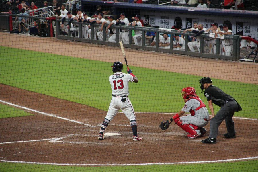 Atlanta Braves player Ronald Acuña Jr at bat in a baseball game in Atlanta.