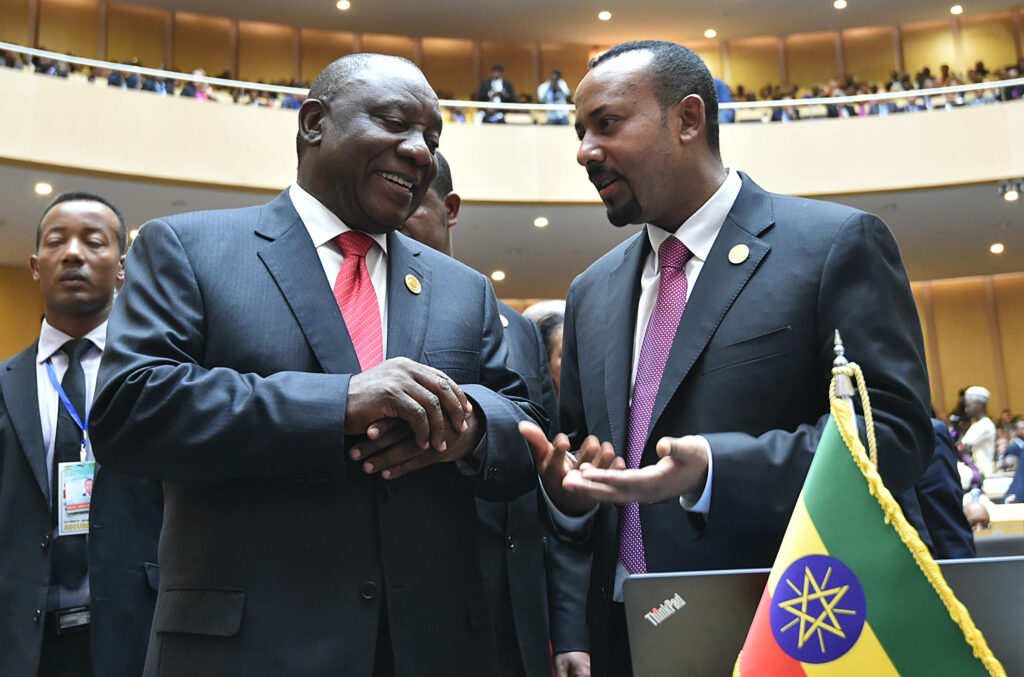 "President Cyril Ramaphosa with Prime Minister of Ethiopia Abiy Ahmed during the opening session of the 32nd Ordinary Session of the Assembly of Heads of State and Government of the African Union. The Assembly takes place from 10-11 February 2019 under the theme: ""The Year of Refugees, Returnees and International Displaced Persons: Towards Durable Solutions to Forced Displacement in Africa"". It presents an invaluable opportunity to reflect on and address the root causes of forced displacement in Africa. 10/02/2019 Kopano Tlape GCIS"