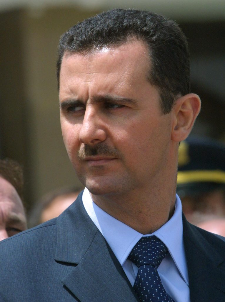 Syrian President Bashar al-Assad attends the depar