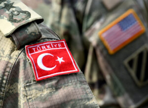 Turkish flag and US flag on army uniform. Turkish and US troops