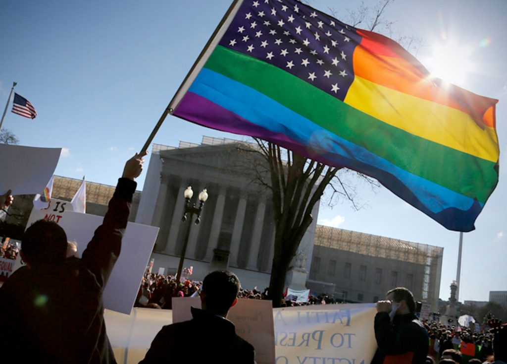 Anti-Proposition 8 protesters wave a rainbow flag in front of the U.S. Supreme Court in Washington