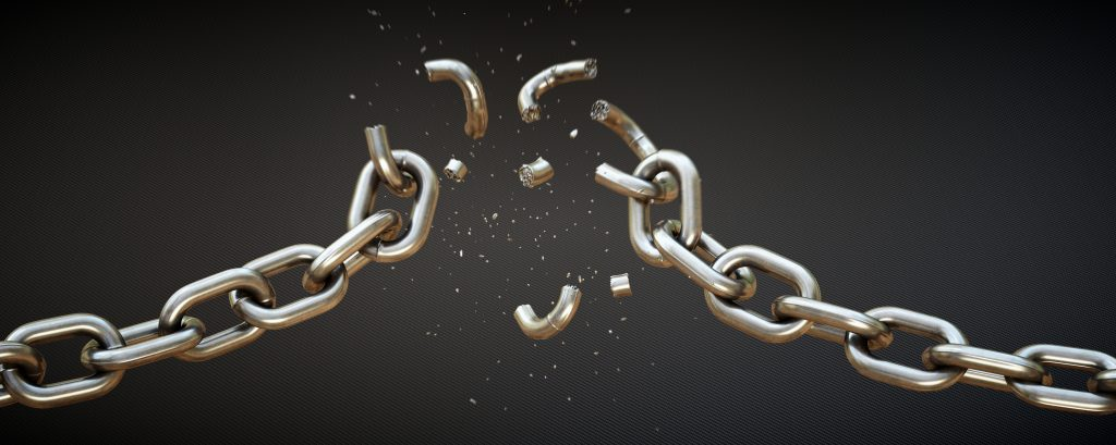 This scene shows a chain falling apart under strain of force. The chains central links are breaking apart and many small fragments are blowing vertically out. The scene is isolated on a dark patterned background.