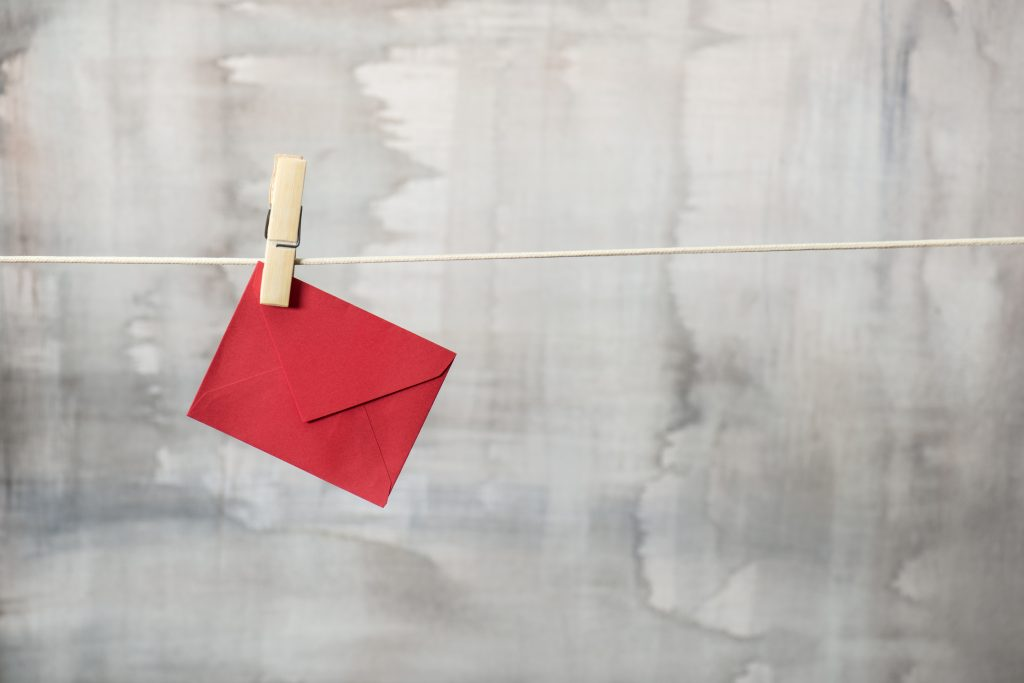 Red+colored+envelope+is+hanging+on+a+clothesline