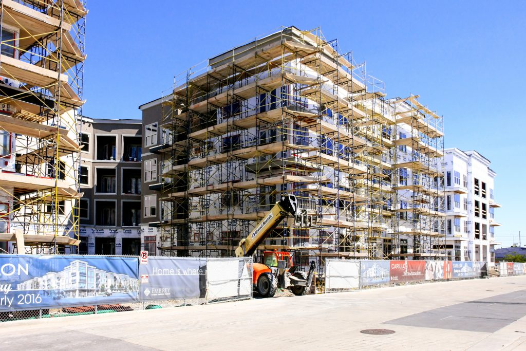 Nashville, TN, USA - April 9, 2016: Scaffolding around a new apartment complex in the booming city of Nashville in Tennessee
