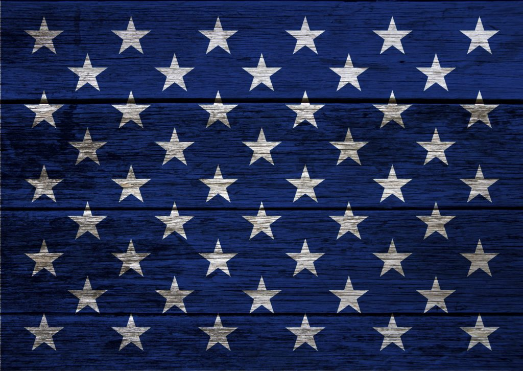 Image with decorative elements that refer to the American flag on wood background. Colorful background usable for USA politics and government, celebration events, american contents, national landmarks and wallpaper. XXXL size concept image.