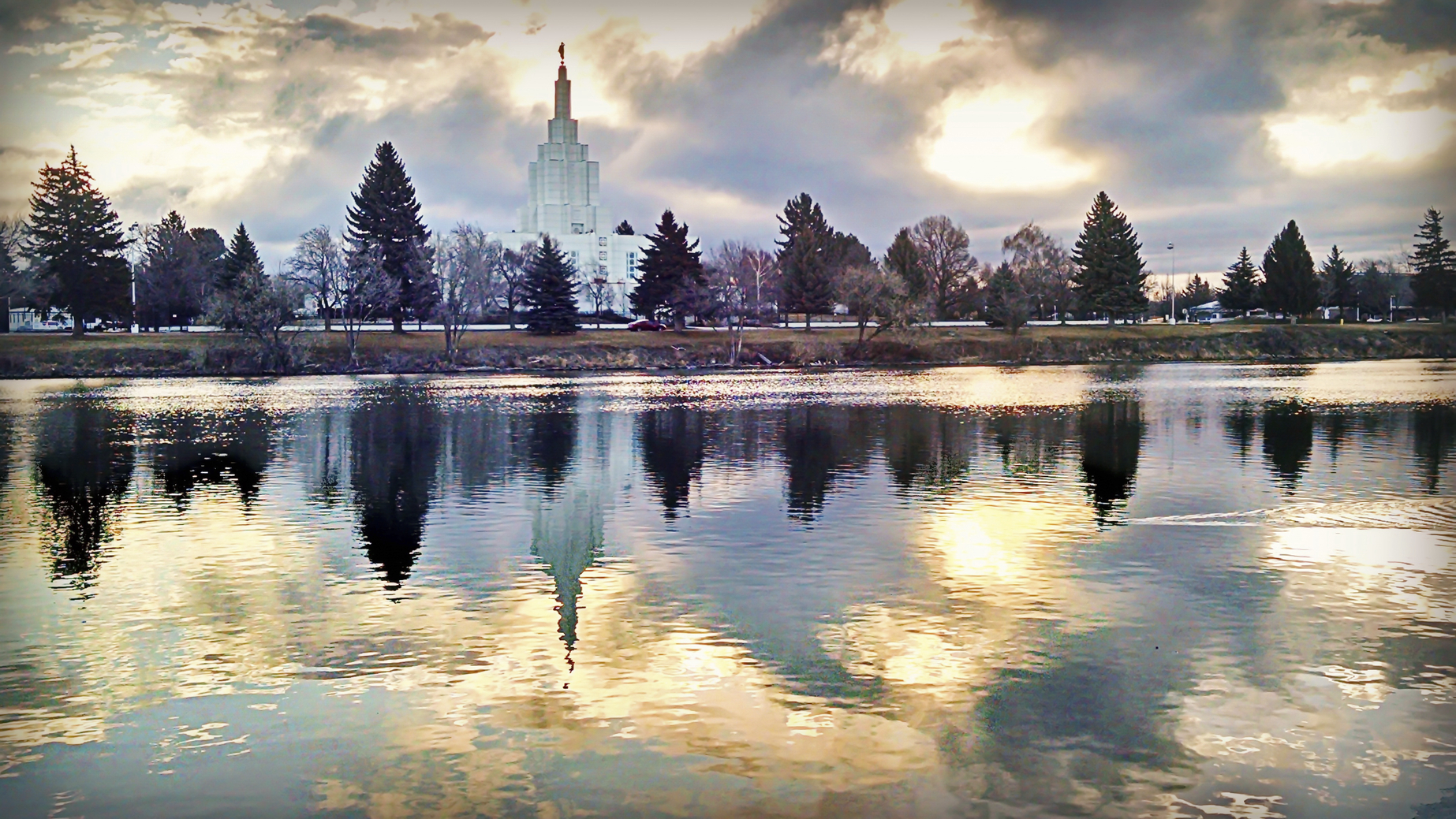 Storm moving through left this beautiful reflection of the sunrise on the Snake River of the Idaho Falls Temple.